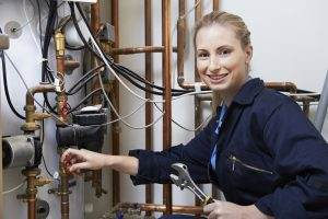 Woman training to be a plumber